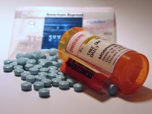 pills next to pill bottle