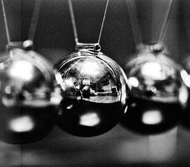 photo of newton's cradle (pendulum toy with shiny chrome balls)