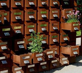 Wooden card catalog with flowers in it