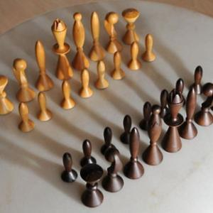 wood chess figures on table
