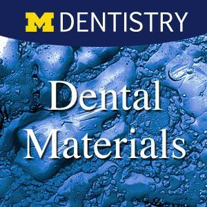 "Words ""Dental Materials"" displayed over textured background"