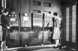 Old photograph of two women operating a large switchboard