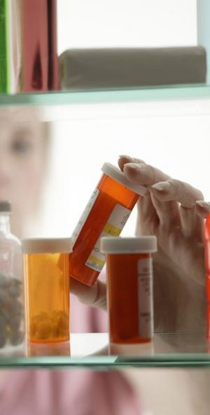 prescription bottles being held by employee