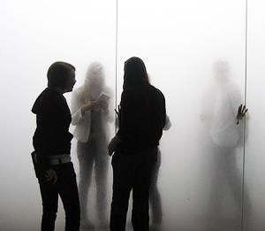 Shadowy image of people standing in a group