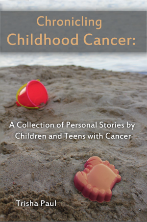 Book cover with sand bucket and toy crab on beach